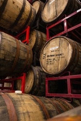 Wooden Bourbon barrels used to age mead, stacked on racks at a mead brewery in Baltimore.