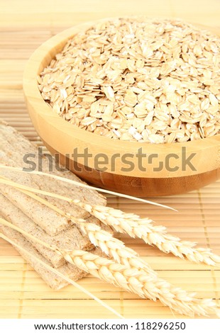 wooden bowl full of oat flakes