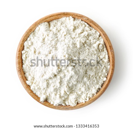 wooden bowl of flour isolated on white background, top view
