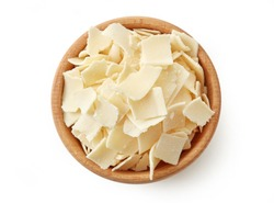 Wooden bowl of parmesan cheese flakes