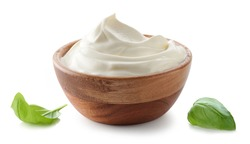 wooden bowl of whipped sour cream yogurt isolated on white background