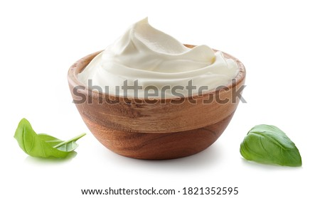wooden bowl of whipped sour cream yogurt isolated on white background Photo stock ©