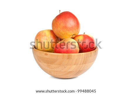 wooden bowl with apples isolated on white