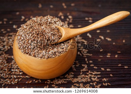 Wooden bowl with flax seeds