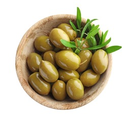 Wooden bowl with green olives on white background