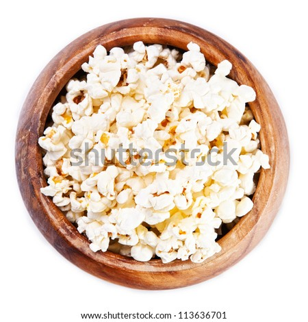 Wooden bowl with popcorn on white background