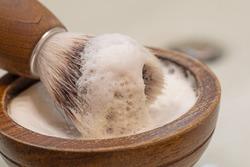 wooden bowl with shaving soap and vegan razor brush