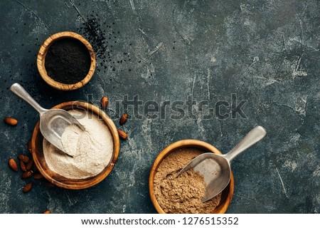 Wooden bowls with almonds flour, black cumin flour and flax seeds flour. Gluten free