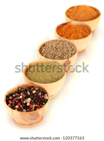 wooden bowls with spices isolated on white