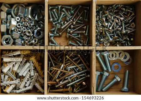 Wooden box for metal bolts, screws and nuts close up