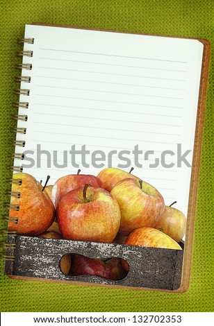 Wooden box full of apples painting on blank notebook page