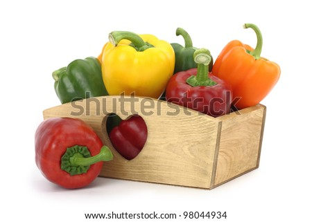 Wooden box full of bell peppers