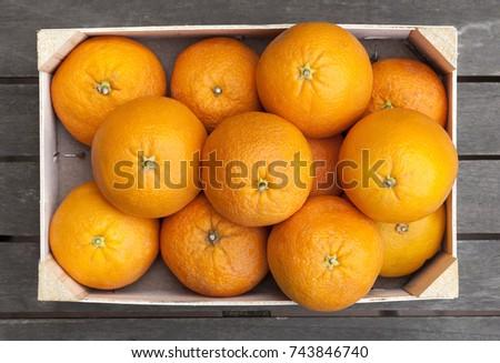 Stock Photo Wooden box of fresh oranges