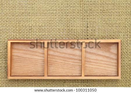 Wooden box tray on burlap background