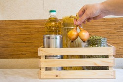 Wooden box with a set of products on the kitchen table concept of donor food.