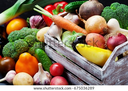 Wooden box with autumn harvest farm vegetables and root crops. Healthy and organic food background. #675036289