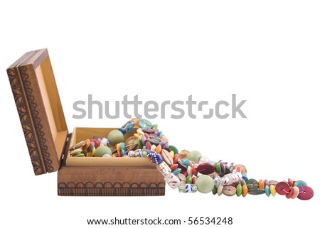 wooden box with fashion beads on white background
