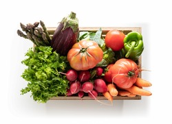 Wooden box with fresh vegetables, isolated from the white background. top view