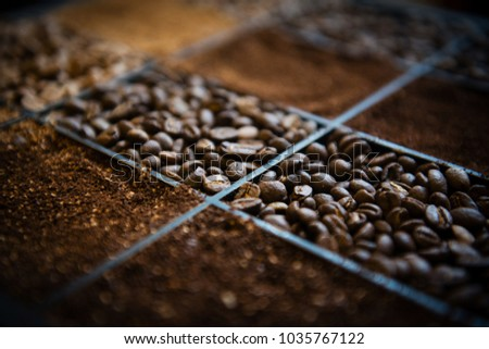 Wooden box with three kinds of coffee beans and ground coffee #1035767122