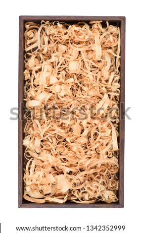 Wooden box with wood shavings straw chips fillings isolated on white. Wine box top view. Stock photo ©