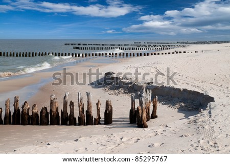 Wooden breakwaters at Baltic sea coast.