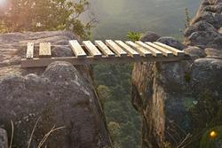Wooden bridge across the gap of the mountain gap.