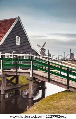 Wooden bridge and barn. Zaanse Schans town, popular tourist attractions of the Netherlands. Suburb of Amsterdam