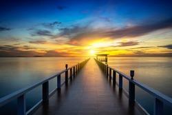 Wooden bridge at the sea at sunset