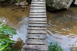 Wooden bridge cross Creek top view.