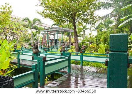 wooden bridge  cross the lake in green park normal