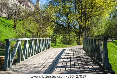 Wooden bridge in the park in Tallinn, a beautiful spring day #363427019