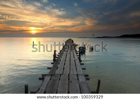 Wooden bridge in the sunset on the Ao Ngam Kho at Koh Kood, Trat in Thailand