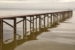 wooden bridge in to the sea at Phetchaburi Thailand