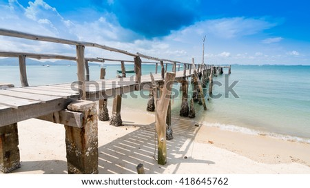 Wooden bridge into the sea.One of the most beautiful and most popular beaches at ao Noina on Koh Samet.Crystal Sand Beach at Samet Island