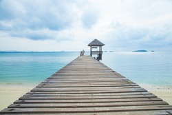 Wooden bridge into the sea. Property is located at the end of the runway into the sea.