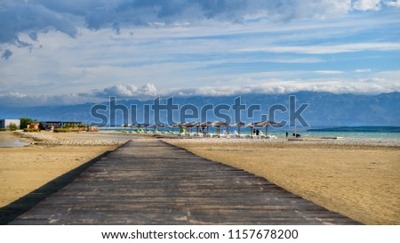 Wooden bridge leading to Famous Queens Beach in Nin near Zadar, Croatia. Rare sand beach in the Adriatic sea, due favorable wind the beach is popular for surfing and kitesurfing