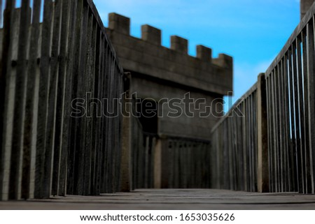 Wooden bridge of the medieval castle, blue and clean sky.