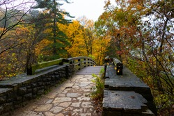 Wooden bridge on a cloudy Autumn morning.  Starved Rock State Park, Illinois, USA