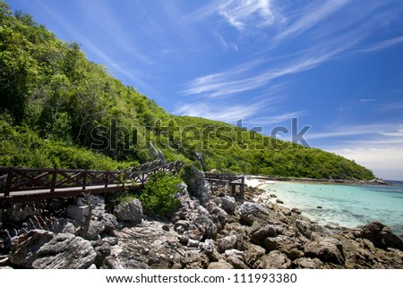 Wooden Bridge on Beautiful turquoise seascape and white sandy beach of Koh Lan, Pattaya, Thailand