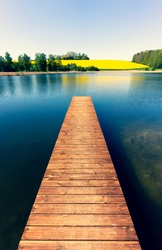 Wooden bridge on the lake in spring