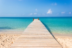 Wooden bridge on the tropical beach and blue sky summer background