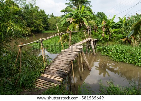 Shutterstock Wooden bridge over a canal of Can Tho, Vietnam. Can Tho is the biggest city in the Mekong delta.