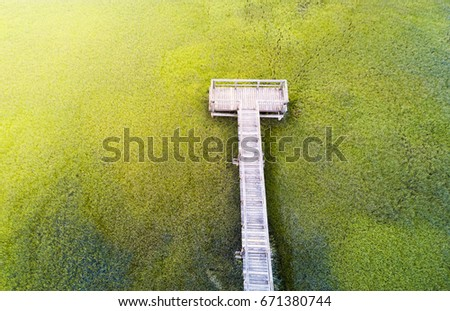 Wooden bridge over a swamp aerial view