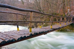 Wooden bridge over mountain river