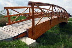Wooden bridge over the small grassy ditch