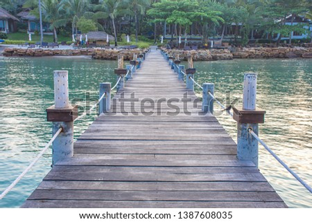 Wooden bridge pier boat in the summer sea and the bright sky. #1387608035