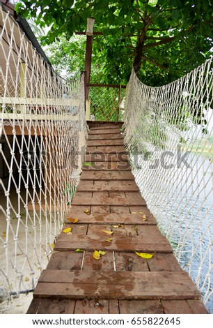 Wooden bridge suspension bridge #655822645