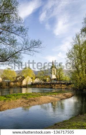 Wooden bridge to Kostanjevica na Krki town. Stock photo ©