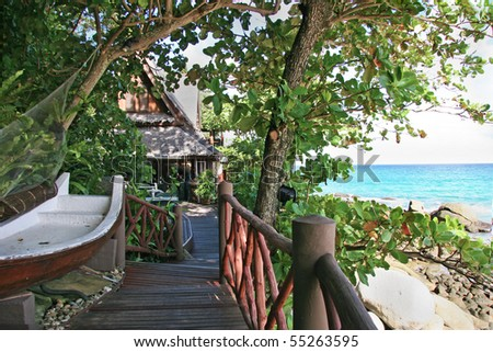 wooden bridge to the hut in the tropical island