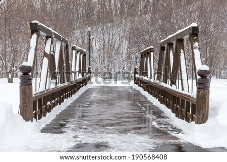 Wooden bridge with snowy surface